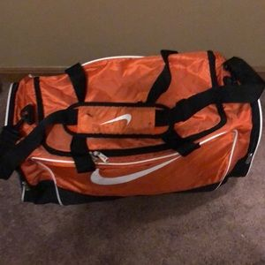 Nike Bags - Nike Duffel bag Orange and black large travel bag